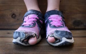 POOR SHOES 300x188 - Child Poverty Monitor Report 2021
